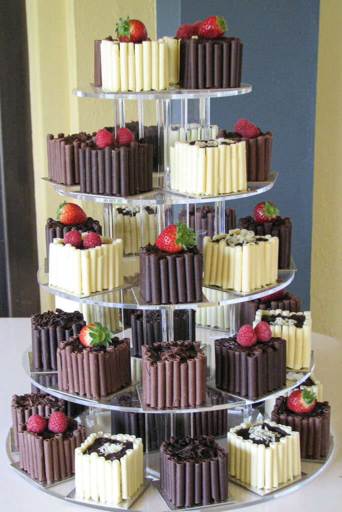 individual square chocolate cakes for a wedding
