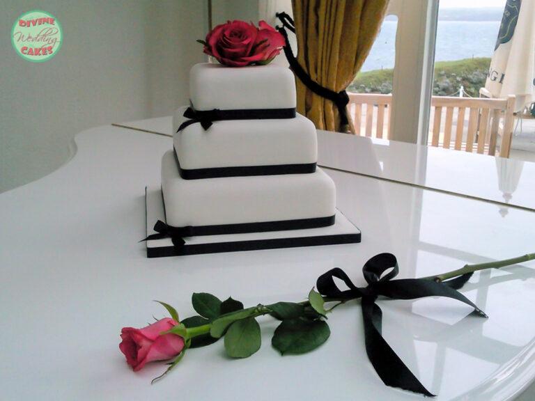 Fondant iced cake with roses & black ribbon