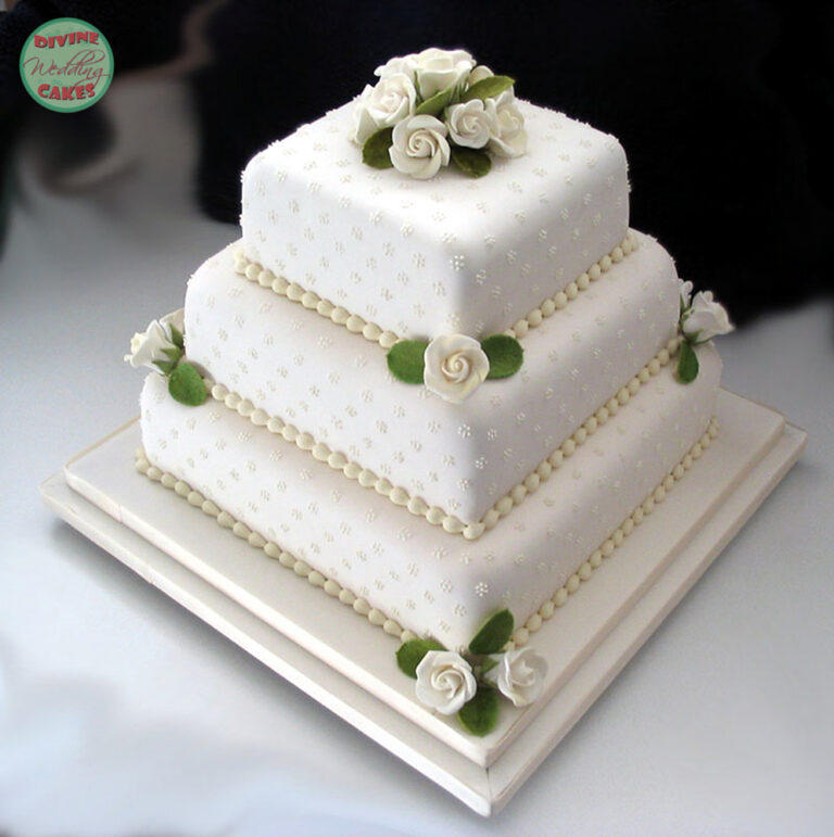 Fondant iced cake with sugar roses, leaves & piped dots