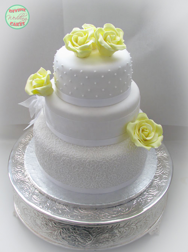 Fondant iced cake with yellow sugar roses