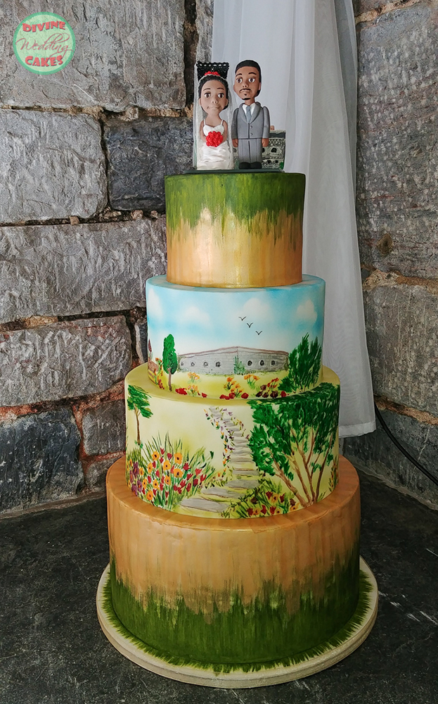 a wedding cake with the fort wedding venue hand painted on the sides