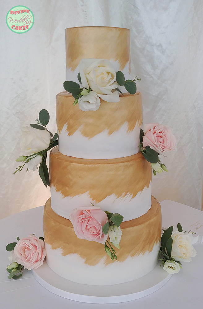 Fondant iced cake with roses and gold colouring