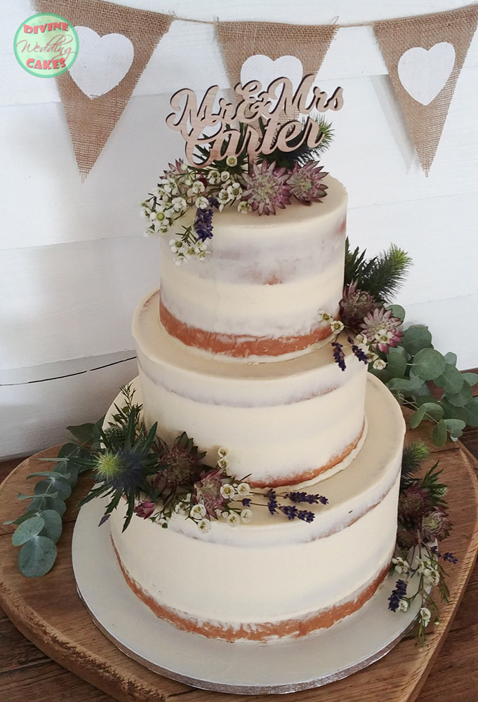 Semi-naked rustic cake with fresh flowers