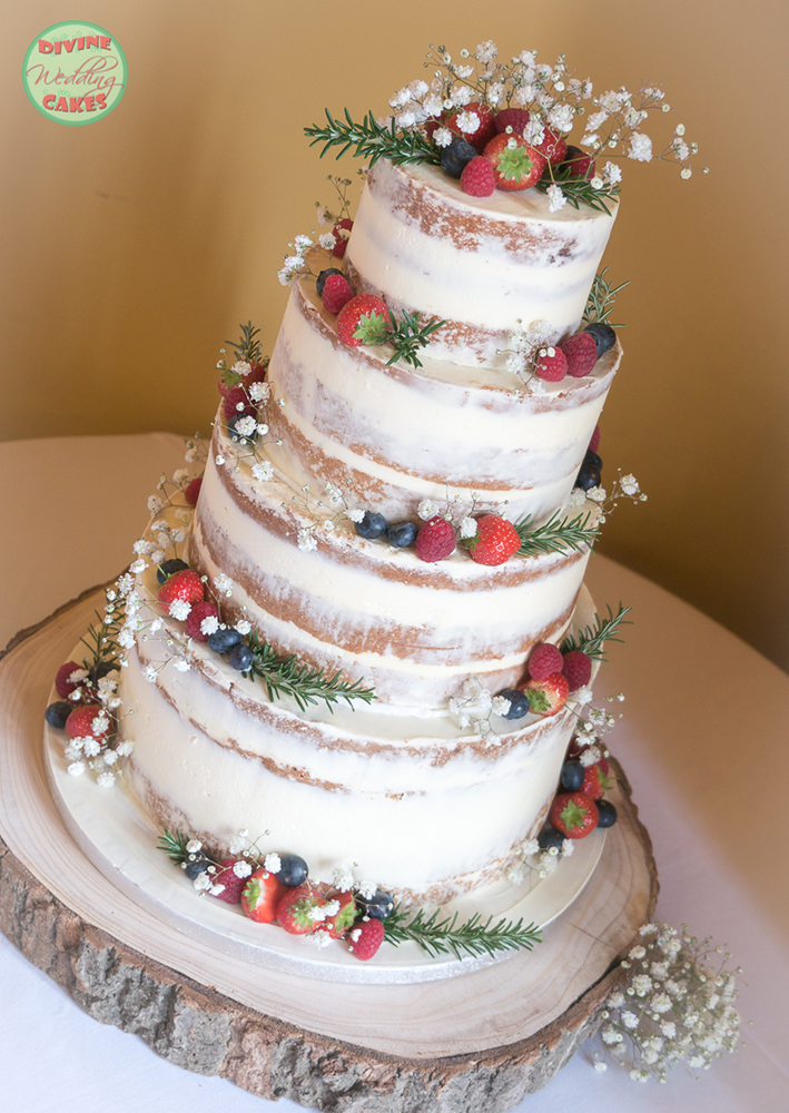 Semi-naked cake with berries & rosemary