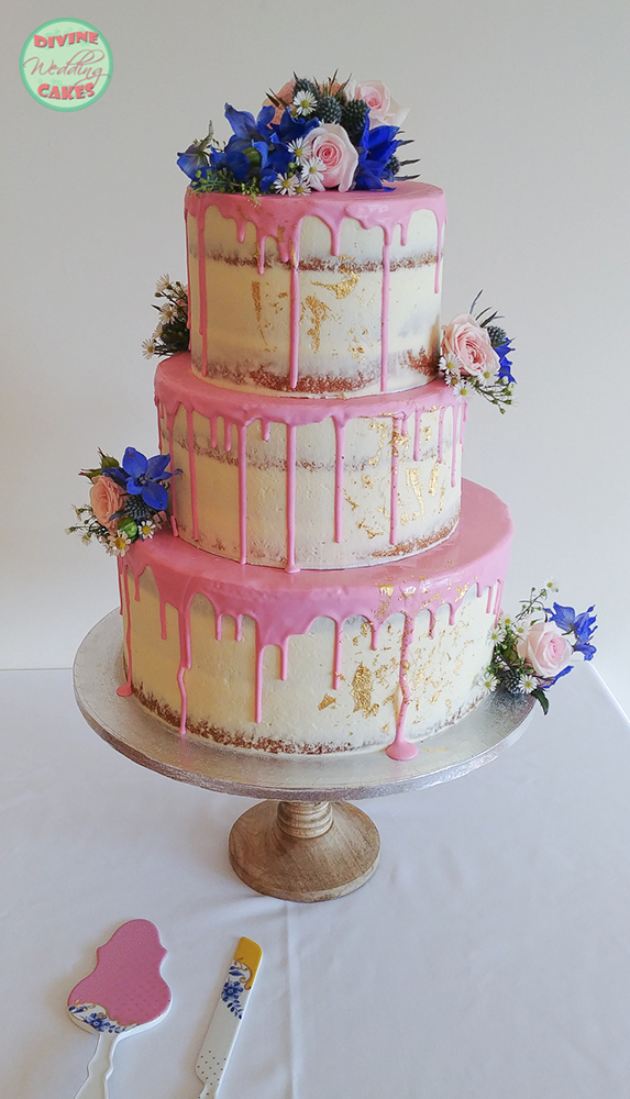 Semi-naked cake with drip icing & fresh flowers