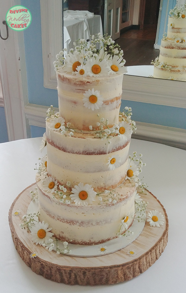 Semi-naked cake with fresh daises