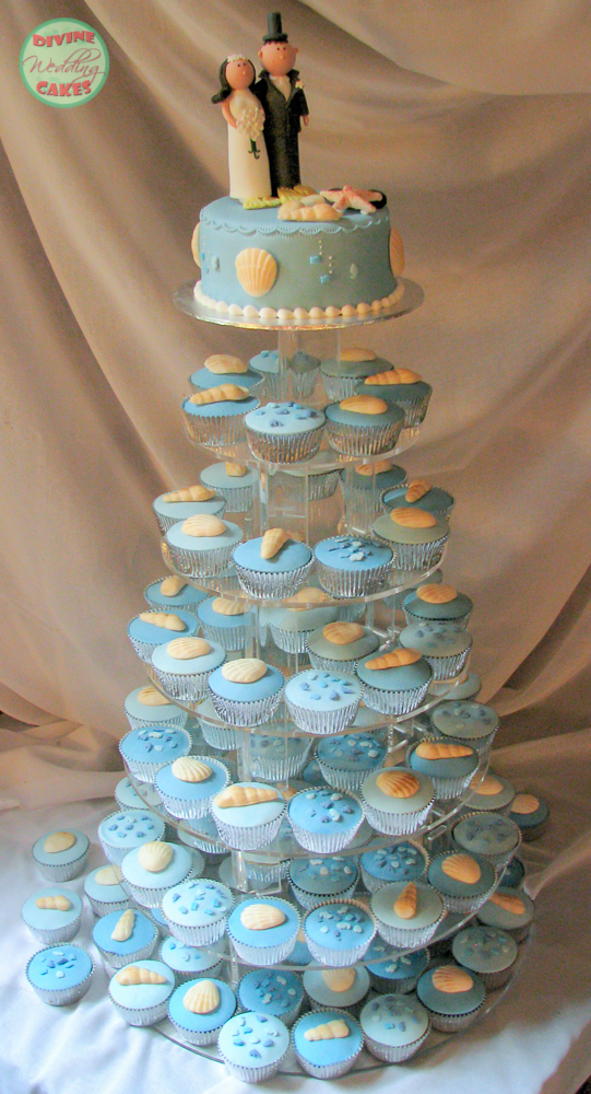 a tower of cupcakes for a wedding with a beach theme