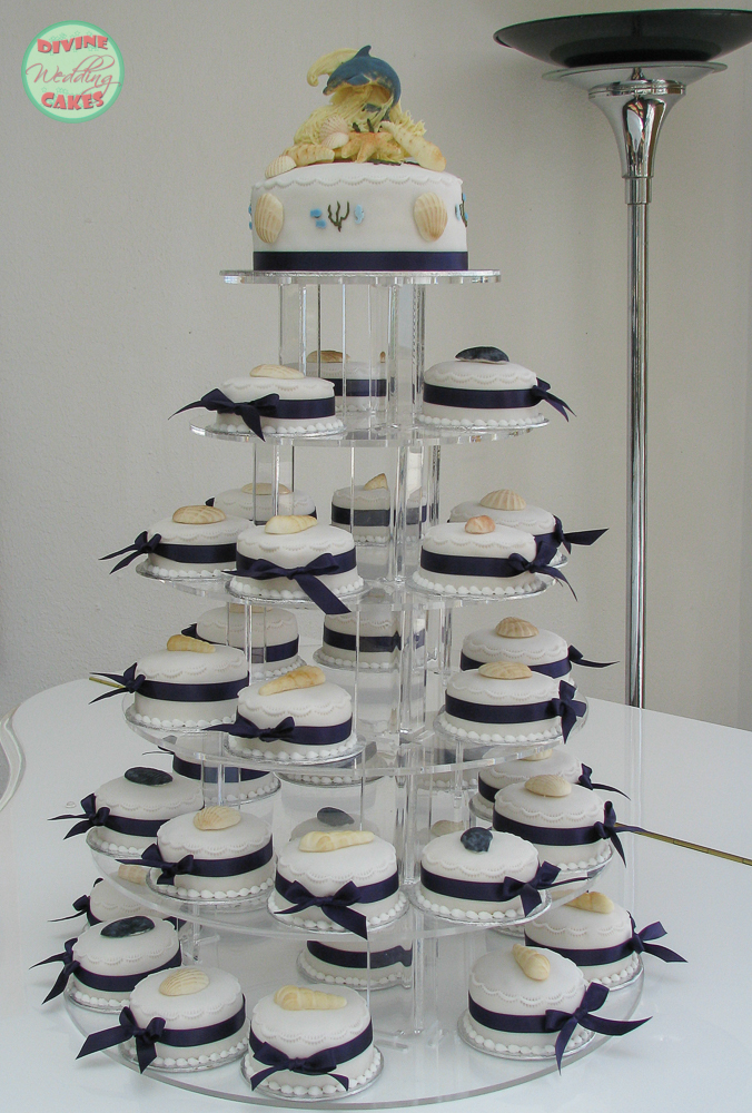 a tower of mini wedding cakes with a beach theme