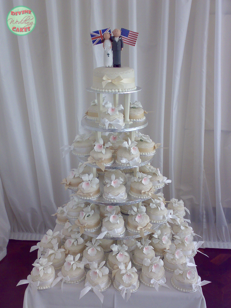 a tower of individual wedding cakes with sugar orchids on
