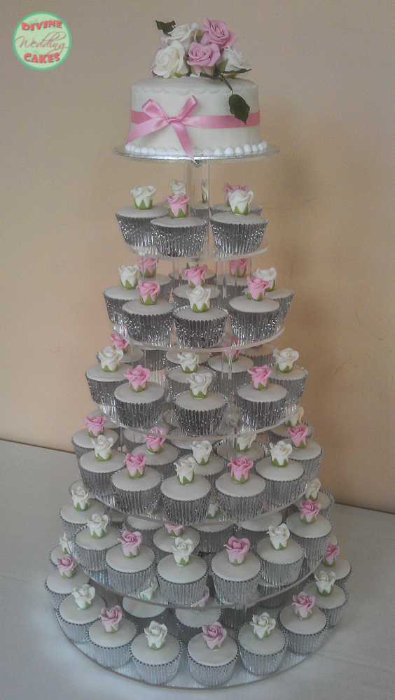 a tower of iced cupcakes for a wedding